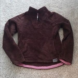 The North Face dark brown sweater.